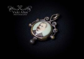 1901 - 1910  Gilt Metal Edwardian Photo Pendant - Lady one side, Gent the other (SOLD)
